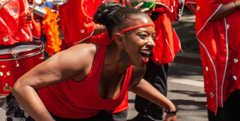 young-pretty-african-american-woman-in-red-dancing-at-ethnic-festival-in-paris-black-girl-having-fun_t20_nLxjKA